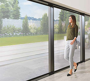 Aluminium Sliding Doors are a sleek, modern choice for a full length glass door leading to a patio or garden.